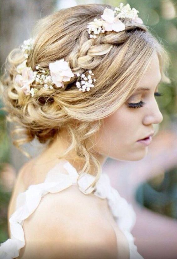 Baby's breath and tiny white roses interwoven through the brides braid ensure this look is as lovely as can be.