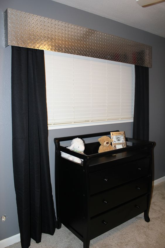 Totally doing this if we ever have a boy! Orange curtains & right accessories=construction theme!