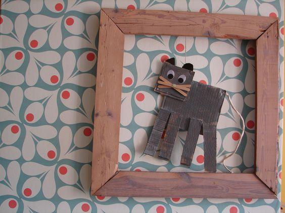 Kat gemaakt door Puck in  de kleuter kader gemaakt van oude planken