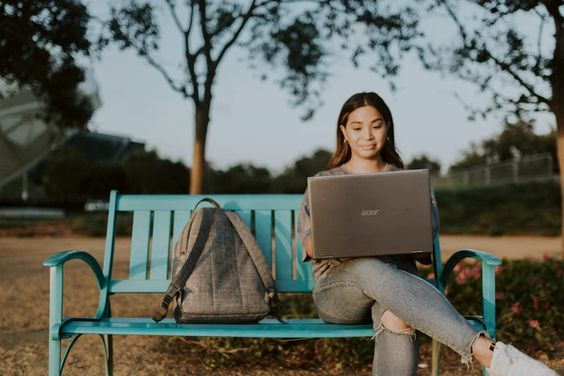 woman in brown long sleeve shirt sitting on blue metal bench photo – Free Bench Image on Unsplash