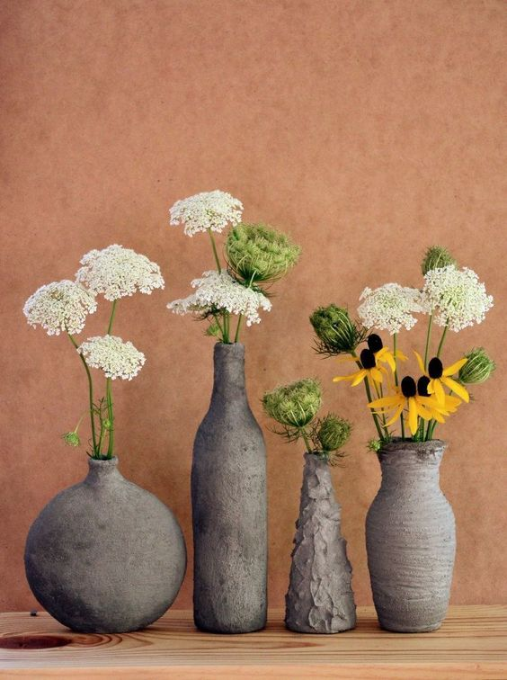 cement-covered glass vases