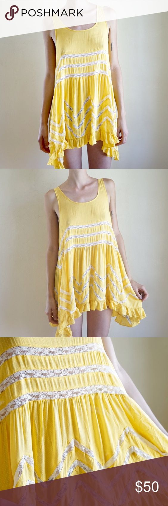 Free People trapeze slip dress Yellow trapeze slip dress in yellow. Polka dot material with lace inlays. The tag has been removed but this is definitely true Free People. Most likely a size S or XS. Great condition. Free People Dresses Asymmetrical