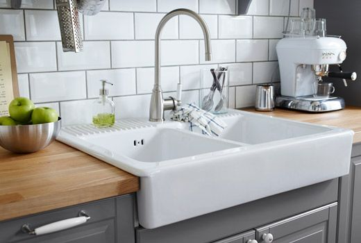 White double bowl farm sink with stainless steel color single lever kitchen faucet