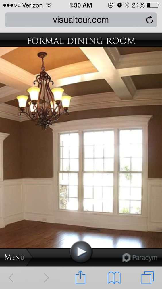 Dining room with wainscoting and coffered ceilings