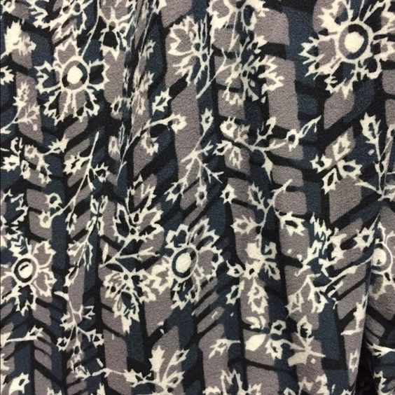 Lularoe TC black/gray floral leggings BNWT Super cute, rare find. Never worn or tried on, BNWT. Nothing wrong, just didn't love them as much as I thought I would. :-) LuLaRoe Pants Leggings