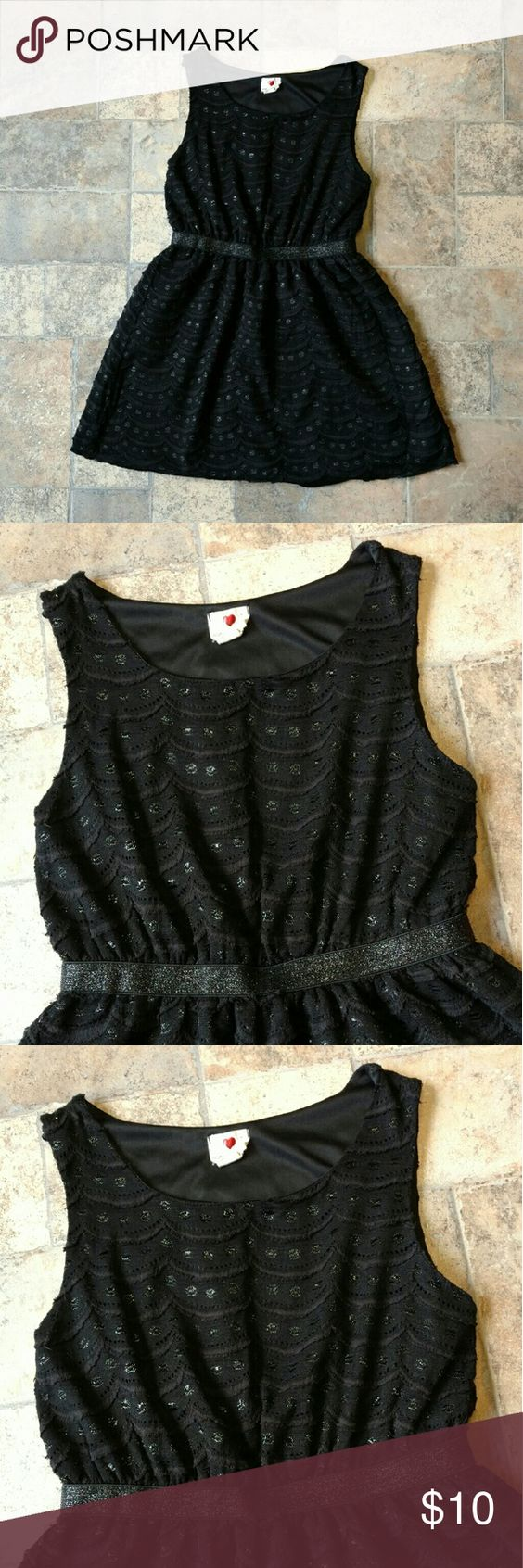 """Cute black mini dress This dress is in great condition. Black with shiny black detailing. Size large. 30"""" long. Measures 16"""" armpit to armpit. Shell: 40% cotton, 10% rayon, 50% nylon. Lining: 100% polyester. Any questions, just ask! one clothing Dresses Mini"""