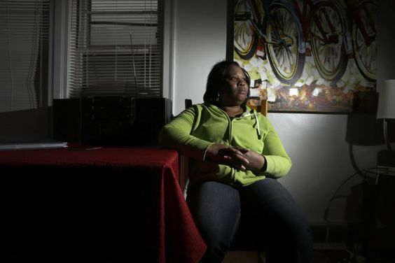 """A tale of 2 Ferguson deaths: 1 well known, 1 anonymous - Yahoo News In this Monday, Feb. 9, 2015 photo, Maria Joshua, mother of DeAndre Joshua, poses for a photo at her home in University City, Mo. Her 20-year old son was killed in the hours after the Nov. 24, 2014 announcement that a white police officer would not be indicted in the killing of 18-year-old Michael Brown. """"What I'm afraid of is the unknown, seriously, the unknown. I don't know who did this, and why. But I do want some…"""