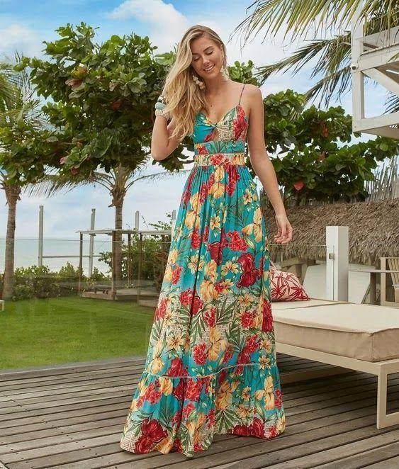 Para as aquelas que amam praticidade e conforto, usar vestido longo no verão é uma opção elegante e fresquinha, pois vestidos são peças que podem ser usados em qualquer ocasião dependendo do seu material e modelagem. #Vestido #VestidoLongo #VestidoLongoEstampado #VestidoLongoFloral #VestidoColorido #VestidoAzulEVermelho