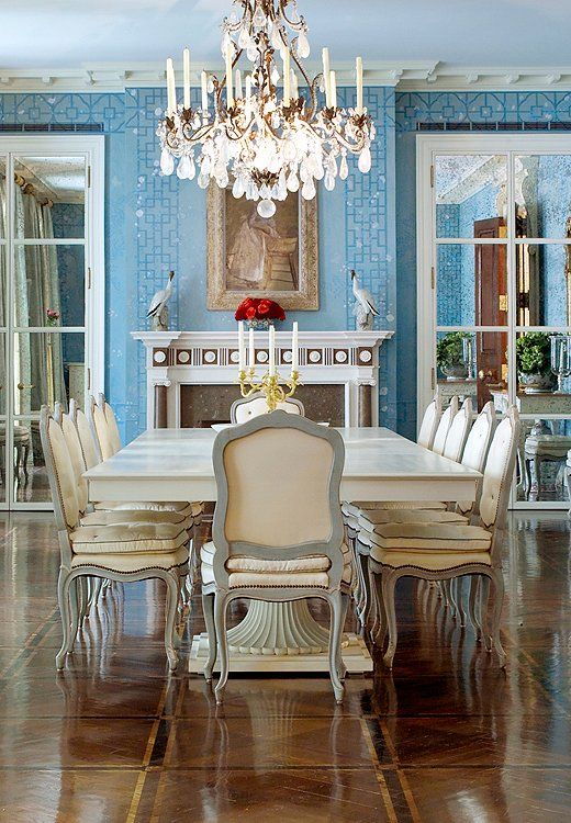 Markham Roberts is all about custom creations. He designed the mantel, stenciled floor, and multiple-pedestal dining table of this New York City Beaux Arts mansion.#diningroom #traditional #interiordesign