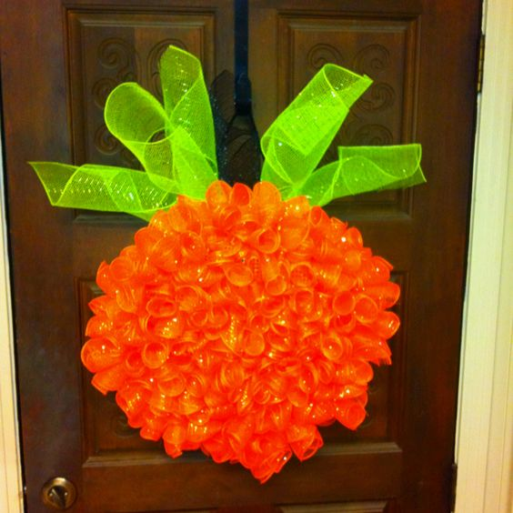 Pumpkin wreath. Check out my past pins for steps on how to DIY.