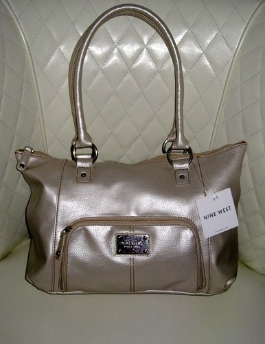 'BNWT Nine West Metallic Tote Bag ' is going up for auction at  7pm Mon, Apr 21 with a starting bid of $20.