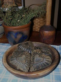 ~ Primitive Hearts in a Wood Bowl ~ If I collected hearts these old heart molds would be in my collection....