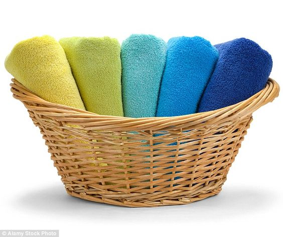 If you add a cap of white vinegar to the rinse cycle, it will disperse any remaining soap and give you a soft, fluffy towel