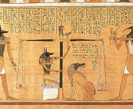 In this ~1275 BC Book of the Dead scene the dead scribe Hunefer's heart is weighed on the scale of Maat against the feather of truth, by the canine-headed Anubis. The ibis-headed Thoth, scribe of the gods, records the result. If his heart is lighter than the feather, Hunefer is allowed to pass into the afterlife. If not, he is eaten by the crocodile-headed Ammit.