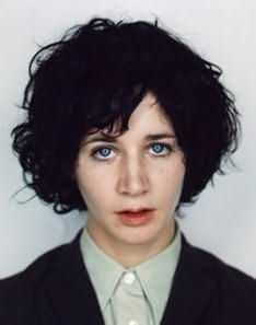 Miranda July. Love the outfit, quirky hair & blank stare. kinda reminds me of a mug shot..