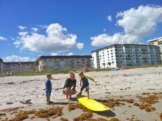 surf lesson cocoa beach using a soft top surfboard