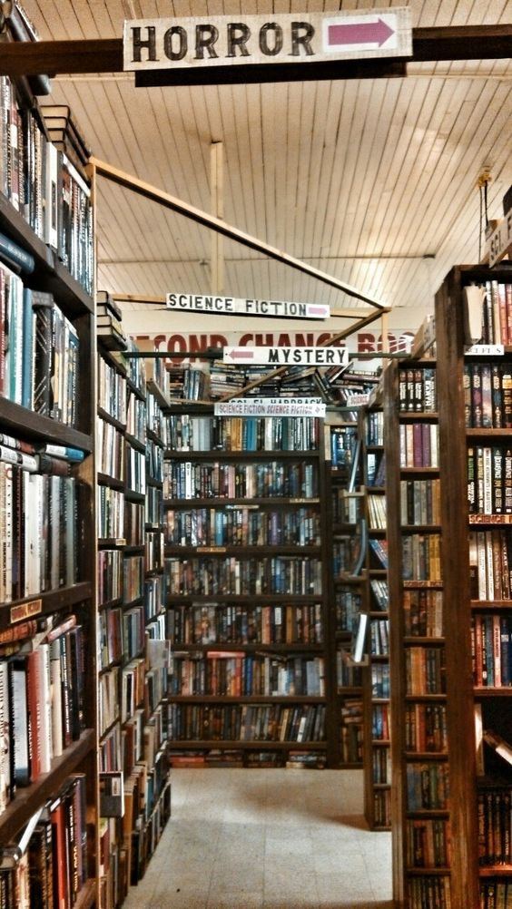 #BookstoresToVisit Second Chance Books, Independence, Oregon ~ Oh, to browse here! The placard section markers are delightful!