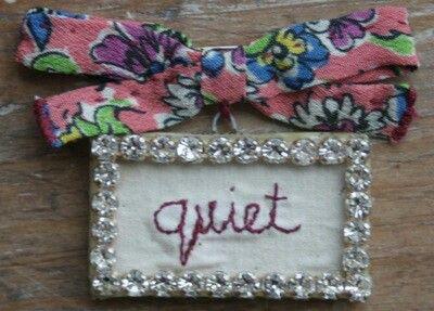'quiet' word brooch: Julie Arkell