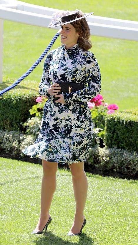 Princess Eugenie wore a blue and yellow floral Erdem number featuring a pie crust collar, opted for a straw boater festooned with origami flowers by Sally-Ann Provan Millinery, teamed with a pair of studded courts and a Yves Saint Laurent clutch, attends the day three of the Royal Ascot 2018