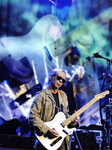 Lead guitarist Tim Reynolds plays a custom telecaster guitar in front of a larger-than-life video image of himself.  John T. Greilick, Detroit News
