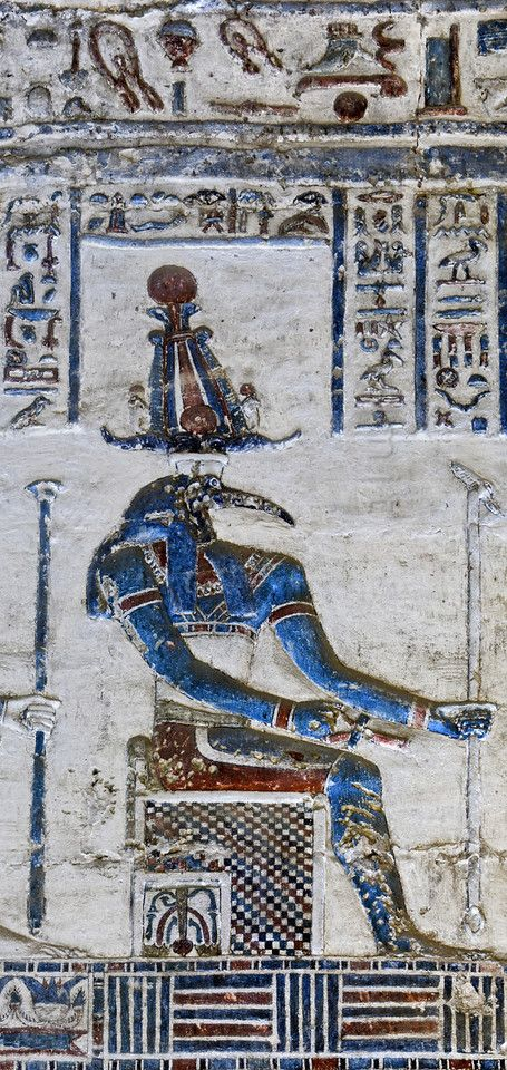 [EGYPT 29623]<br /> 'Thoth in Dendera.'<br /> <br /> 	Thoth, sitting on a throne, is depicted in this relief in the Hathor Temple at Dendera<br /> The relief can be found in the Chapel of Isis, which is one of the shrines located to the east of the central sanctuary. This part of the  Dendera Temple was built during the later Ptolemaic period (first century BC). Photo Paul Smit.