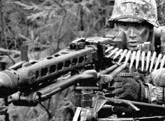 German machine gunner shooting a MG 44. Date and location unknown.