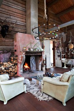 love the chandelier & fireplace...so cozy & cool!