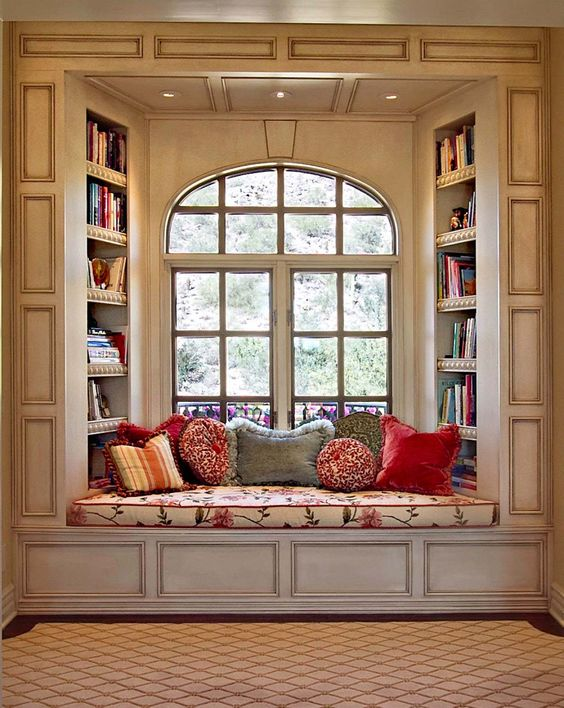 36 Fabulous home libraries showcasing window seats - measure to see if there is room for slanted shelving inside the window seat AND overhead the boys' desks