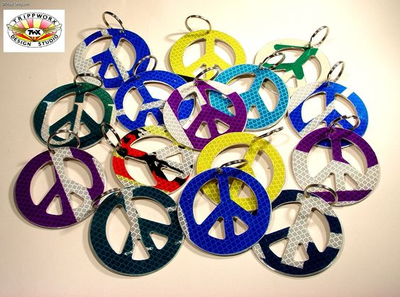 "Peace Sign Key Chain Go in Peace My friend… A GREEN revival of the old peace sign is back! Made from recycled traffic signs, these key chains are not only ""cool"" but the reflective coating makes them a breeze to find... just turn off the light and shine a flashlight!  Available at TrippworX.com"