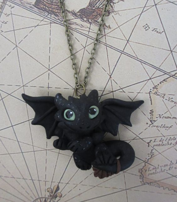 Toothless necklace (How To Train Your Dragon) handmade sculpture pendant $30 available at www.etsy.com/shop/rudeandreckless