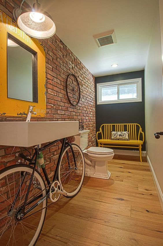 Exceptional powder room with bicycle sink and pops of yellow [Design: Christiano Homes]