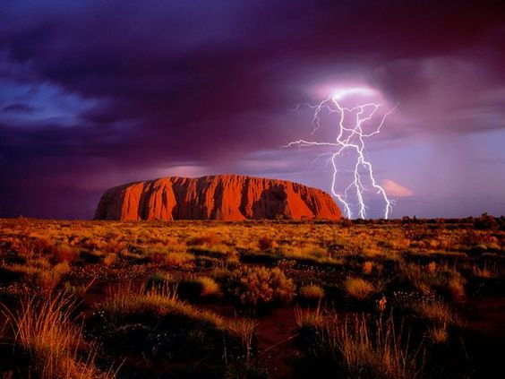 Lightning flashes over Uluru, a landmark red sandstone monolith that draws tourists to Australia's center. Uluru-Kata Tjuta National Park houses the rock, called Uluru by Aborigines, the continent's original inhabitants. Photograph by Mark Laricchia/Corbis