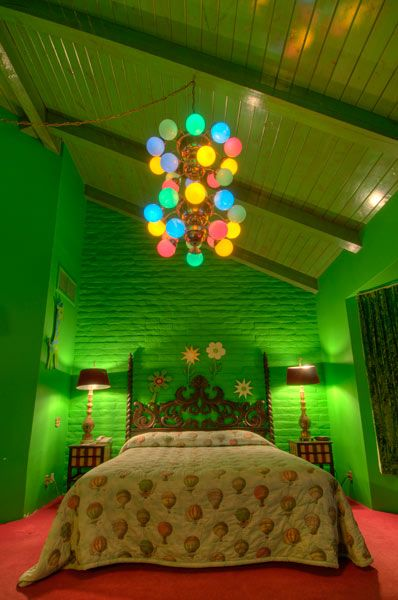 A room in The Madonna Inn, California. Look at the hot air balloon comforter! #mustgo