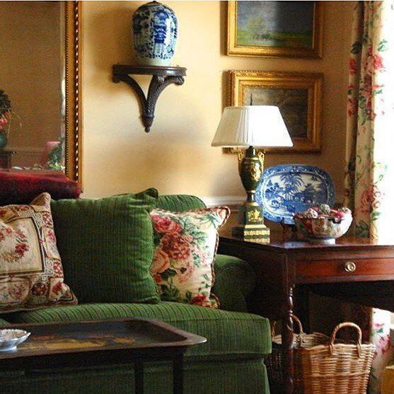 Karen Keysar Beautiful old school Chinoiserie with a green velvet sofa, chintz pillows and curtains, blue and white Chinese porcelain, and needlepoint pillows.