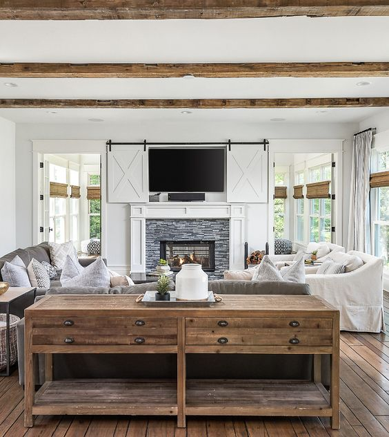 TV behind barn doors recessed over the mantel...love it!