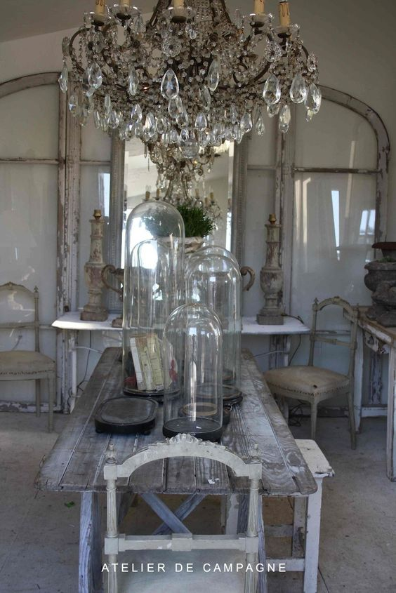 Beautiful chandelier and love all of the glass in the space.