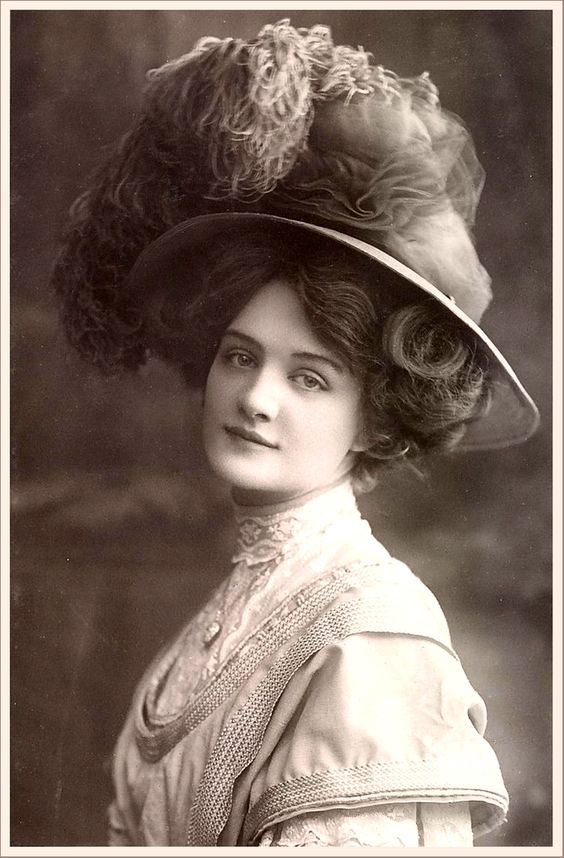 Vintage Gibson Girl Photo. They didn't wear much make up but I love the way they look!:
