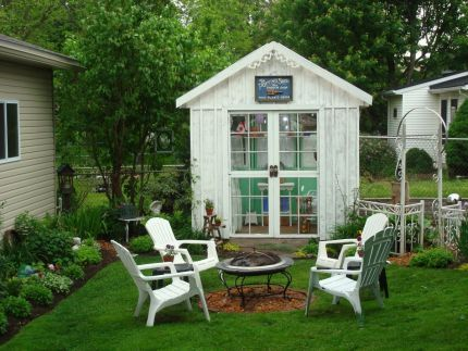 Beautiful potting shed from salvaged materials