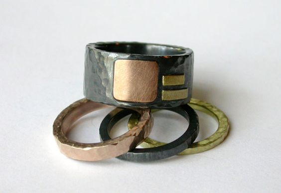 A 10mm wide Cells and Strips ring in oxidized sterling silver and 3 colors of gold!  Coordinated stacking bands for her.