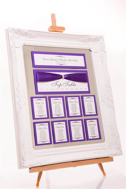 Mirror Framed Table Plan (measuring approx 61cm x 51cm).Choice of white, Black, Silver or Gold frame.Decorated with cadbury purple card, pearlescent paper and satin ribbon.