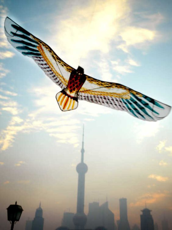 Bird-Shaped Chinese Paper Kite Soaring Above the Shanghai Skyline