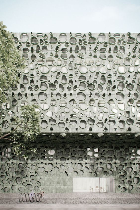 Concrete façade pigmented in green for a Research Institute in Portugal by Cláudio Vilarinho architects and designers.