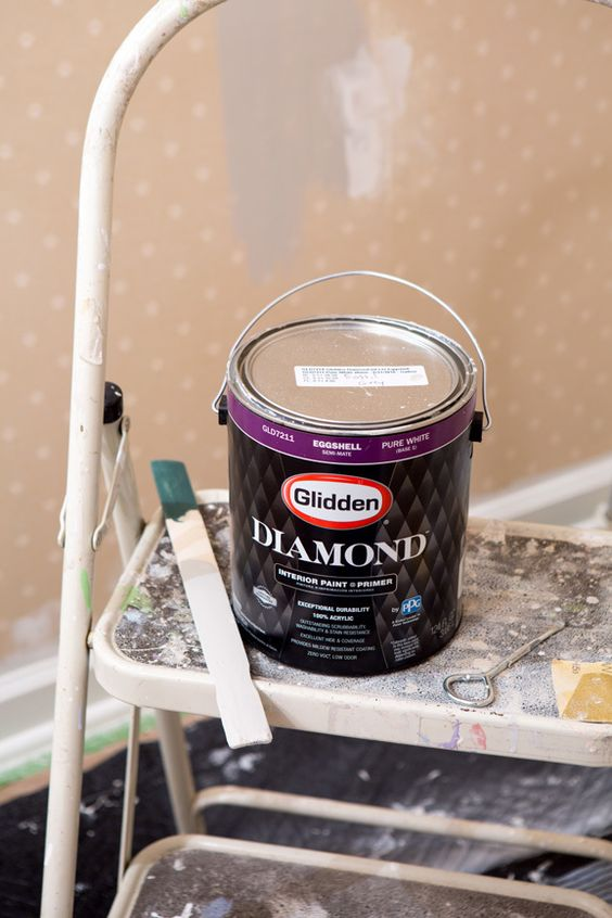 How to paint over wallpaper. This paint did it in on coat and a few touch ups.