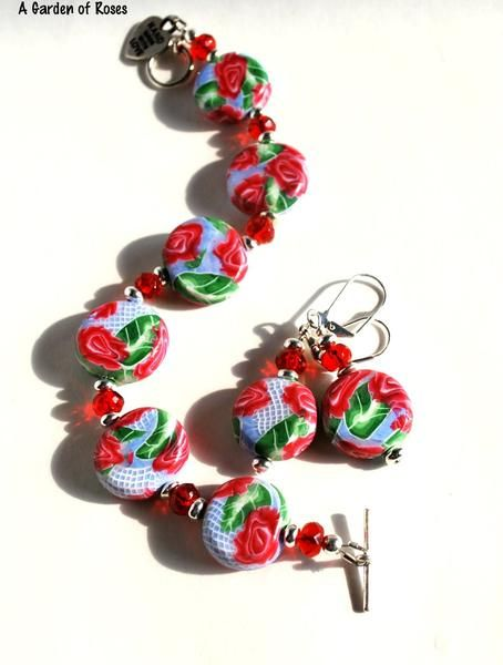 Red Rose Coordinating Bracelet and Earring Set If you love roses, then you are going to love this bracelet and earring set. It's lightweight and fun to wear.  Only one set, so buy it now. Style: Bracelet and Earring Set Materials: Polymer, plated metal, iridescent beads Size: 6 to 7 inches Stock: A Garden of Roses Blue
