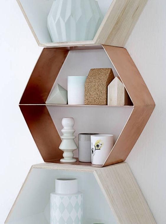 This is an amazing copper hexagonal wall shelf.These shelves are in solid copper and are a Danish design. They look great on their own or randomly stacked and make a really striking feature in any home. They come with two easy fixings for wall hanging. They are not only beautiful, but very useful storage too. A thing to love for a lifetime!Material : CopperW38xH44xD10