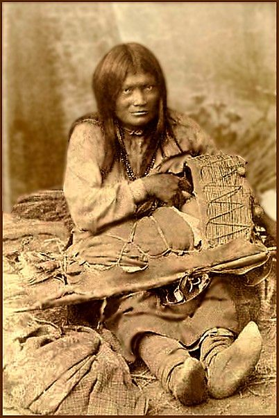 Chiricahua Apache woman in native regalia with Infant in Cradle board. - National Anthropological Archives, Smithsonian Institution.
