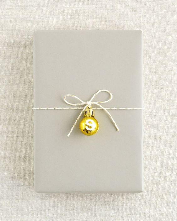 This technique is an easy way to keep gift wrapping clean and classy this holiday season. To personalize your gift tag, add a small letter sticker to the ball ornament. Get the tutorial at SallyJShim.