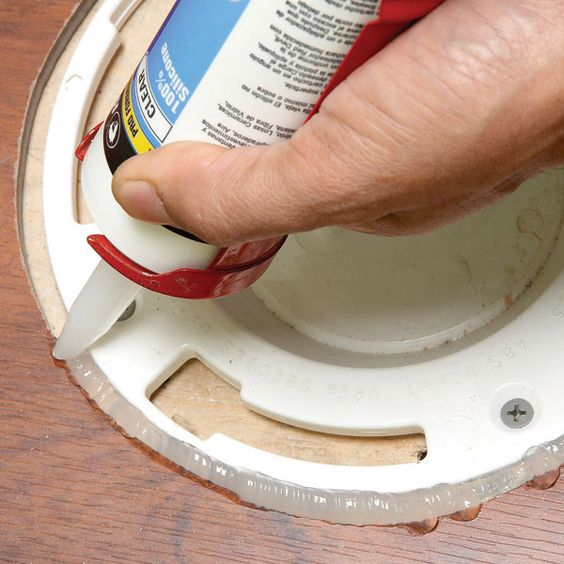 Home repair how to seal laminate flooring expansion gaps for Wood floor expansion gap