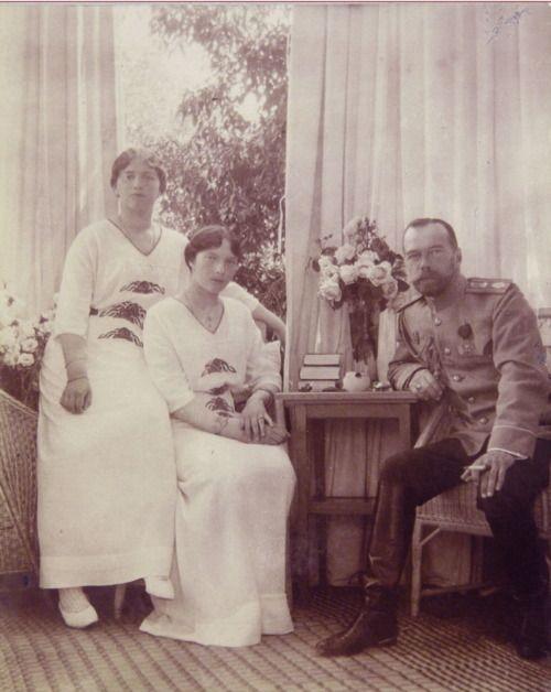 Nicholas II with his daughters Tatiana and Maria.
