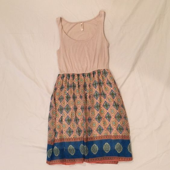 Boho Dress Beige top, stretchy fabric. Skirt is lined and flowy. Only worn a couple times. Dresses